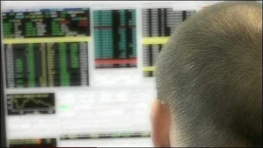 Trader watching market information screens