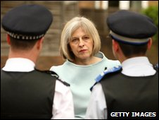 Theresa May and police officers