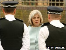 Theresa May with police officers