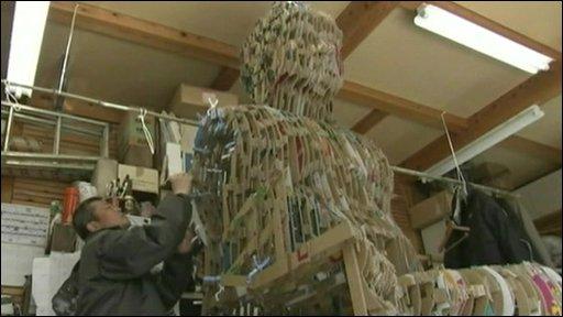 Yuji Honbori working on a Buddha sculpture