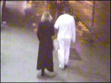 CCTV still of the two suspects as they left after the robbery