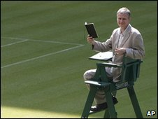 "Matt Harvey the first Wimbledon tennis ""Championships Poet,"" sits in an umpire""s chair as he poses for the cameras at Centre Court at Wimbledon"
