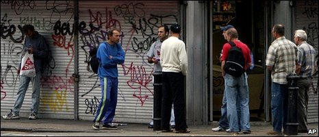 Polish manual workers wait on a street corner for employment in West London