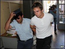 Luke Walker being escorted by police