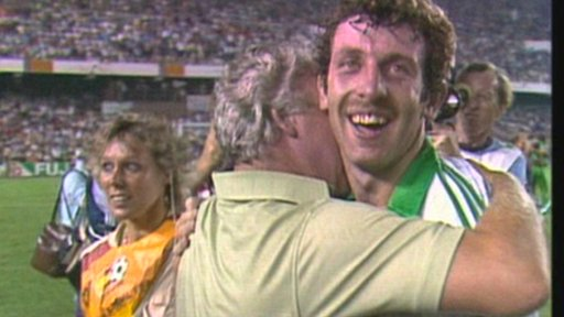 Gerry Armstrong celebrates winning