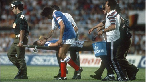 French defender Patrick Battiston is carried off the field