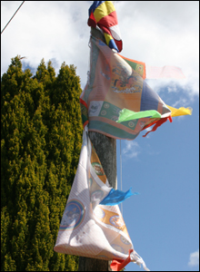 Traditional prayer flags outside Ynys Graianog