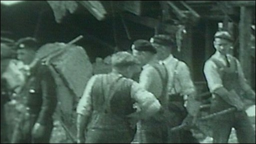 People moving rubble after air raid