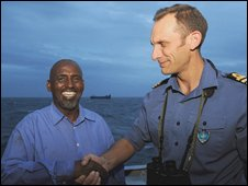 Capt Hassan Madar (left) shakes hands with Commander Simon Huntington