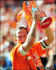 Charlie Adam lifts the play-off trophy
