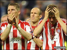 Bayern's Bastian Schweinsteiger and Thomas Muller show their dismay