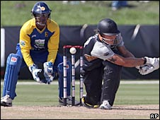 New Zealand batsmen RJ Nicol misses a sweep as Sri Lanka wicket keeper Kumar Sangakkara looks on