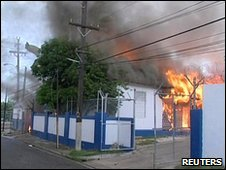 TV grab of police station on fire in Kingston