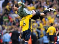 Oxford keeper Ryan Clarke gets a lift from Mark Creighton