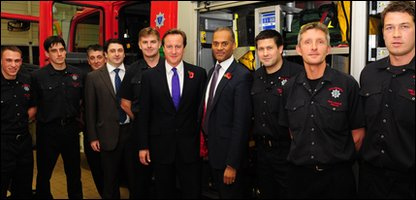 Adam Afriyie with David Cameron and firefighters at Windsor fire station last year
