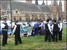 Police search tents in Parliament Square