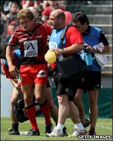 Jonny Wilkinson is helped off the field after getting injured against Cardiff