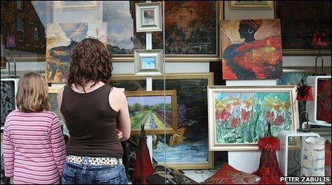 Members of the public view the art in a shop window at Sherwood Art Week 2009