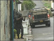 Armed police patrolling Kingston