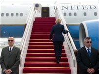 Hillary Clinton boards her plane in Beijing, 26 May