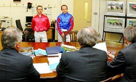 Jockeys answer questions at a steward's inquiry