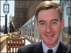 Jacob Rees-Mogg sitting outside the Houses of Parliament