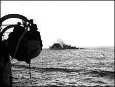 At 1557 she was struck by bombs below the waterline which ruptured the boat's fuel tanks