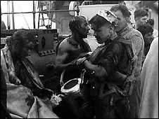Exhausted and covered in oil, many were loaded onto ships bound for the UK