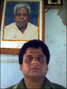 Mahadeb Mallick with his father Nata Mullick's photograph in the background