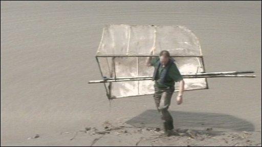 Man carrying elver net