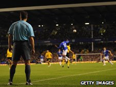 One of the additional referees watches the action behind the goal-line in a Europa League game at Goodison Park