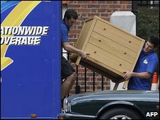 Removal men unpack the Camerons' furnitute in Downing Street