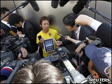Takechiyo Yamanaka speaks to the media after buying an iPad in Tokyo on 28 May 2010.