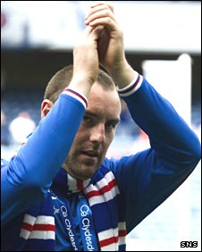 Kris Boyd applauds Rangers fans after they retained the league title