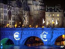 The Pont Neuf bridge lit up with the symbol of the euro