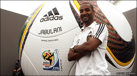 Cacau of Germany poses in front of a giant replica World Cup ball