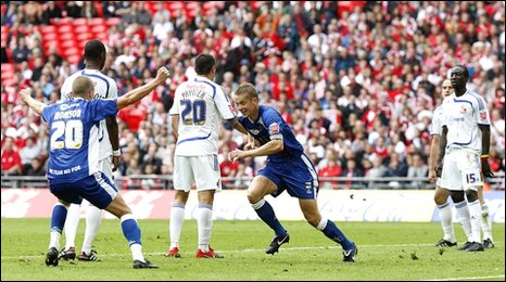 Millwall captain Paul Robinson (centre) scores his seventh goal of the season