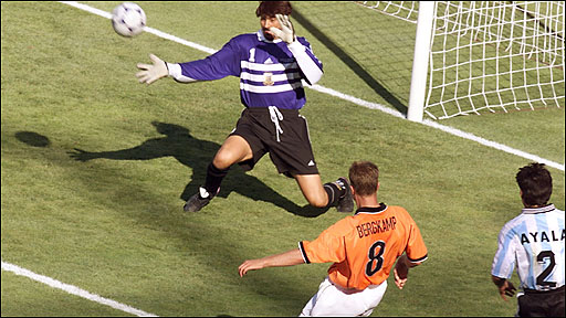 Dennis Bergkamp scores against Argentina in 1998