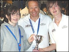 Emily Bashforth, Elliot Dorey and in the centre David Carter holding the trophy for 6th place
