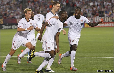 Stuart Holden (right) joins the celebrations for Maurice Edu's (centre) goal