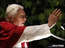 Pope Benedict XVI blesses in front of a replica of the Grotto of Lourdes to celebrate the end of May