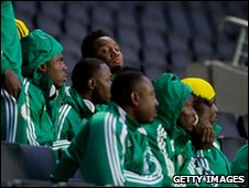 Members of the Nigeria squad watch their friendly with Colombia