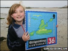 Girl guide with stamp