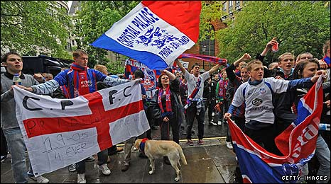 Palace supporters protest outside Lloyds Bank's headquarters