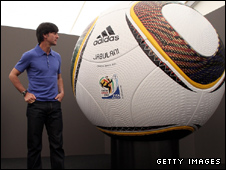 Joachim Loew with a giant mock-up of the ball
