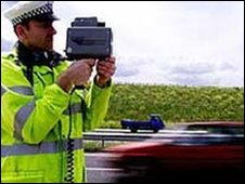 Policeman with speed gun