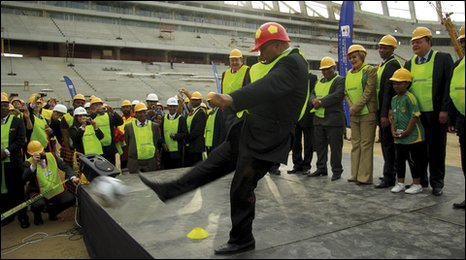South Africa President Jacob Zuma kicks a ball during a tour of of the new stadium in Cape Town