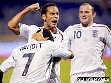 Rio Ferdinand celebrates with Theo Walcott