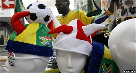Street vendors sell football souvenirs in Cape Town, South Africa