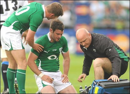 Fergus McFadden recieves treatment at Thomond Park following the injury